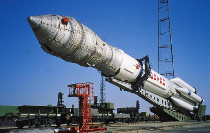 Russian proton rocket carrying an american communications satellite, echo star, being prepared for launch at the baikonur cosmodrome in kazakhstan, may 1998.