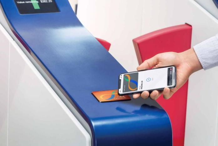 An iPhone with a digital Octopus card being used to beep into a Hong Kong MTR entrance.