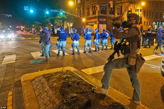 A line of police officers pictured at an intersection in Richmond, Virginia on Sunday evening