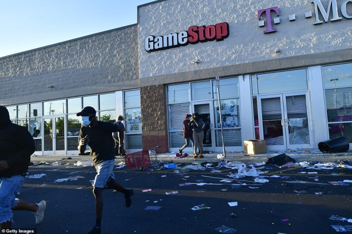 Philadelphia: Officials closed off much of the city after peaceful day protests turned into utter destruction by night fall on Sunday. People pictured running away from a GameStop during civil unrest