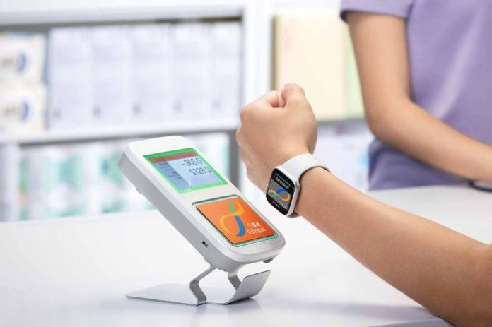 """An Apple Watch can be used to """"beep"""" into counters to make payments."""