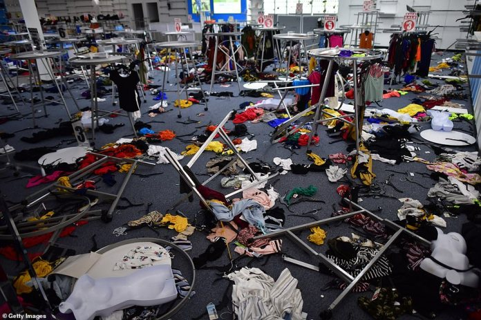 Utter destruction: Stores were left completely destroyed in the store raised with racks swept clean, unwanted clothes thrown on the ground, and shelves empty of merchandise