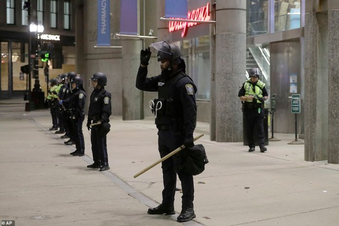 Cops pictured lined up protecting a Walgreens in Boston amid threats of riots and store raids