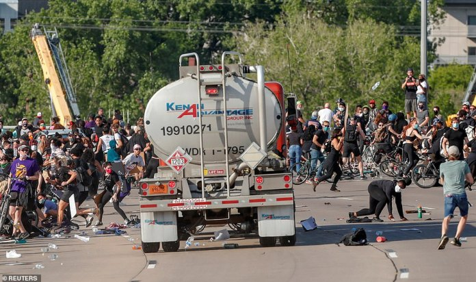 MINNEAPOLIS, MINNESOTA: People flee for their lives as a tanker truck drives towards thousands of protesters on a highway yesterday. The truck did not appear to have struck anyone