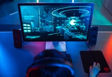 PC gamer gaming on a monitor