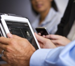 An employee uses personal device at work. An EMM solution can manage and secure it.