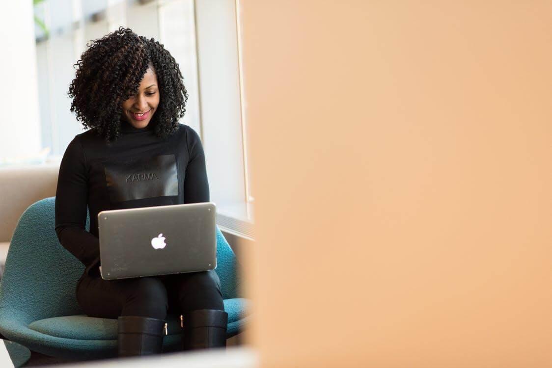Woman Holding Macbook