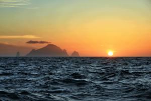 sailing to st kilda with sun setting