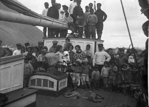 Inuits posing for a picture on board a Tall Ship