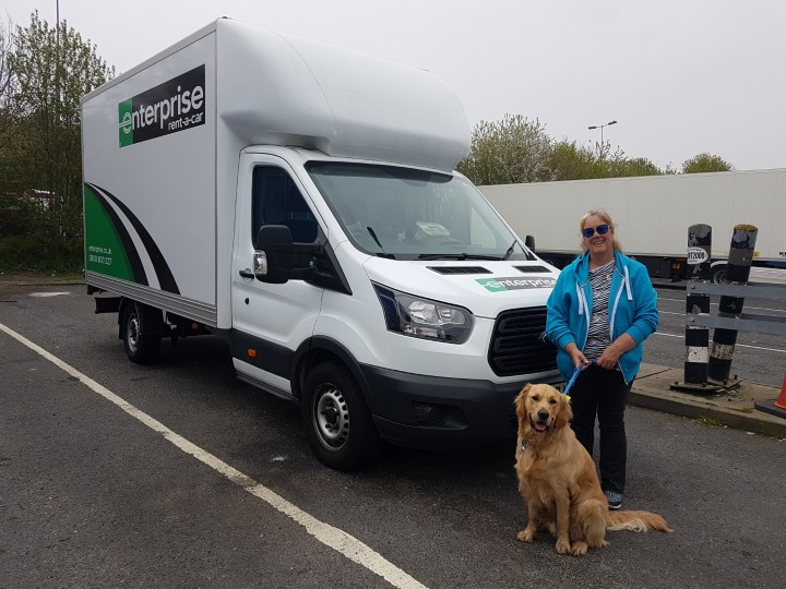 Teddy and Mummy posing in front of a large white Enterprise rented luton van