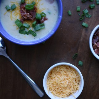 Fully Loaded Baked Potato Soup with all shredded cheddar cheese, bacon crumbles, and chopped green onions!