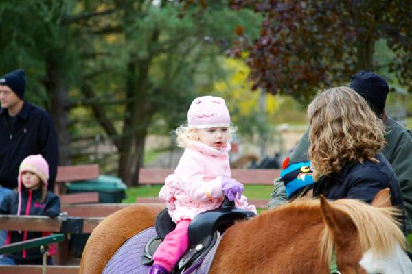 Leah's first pony ride...
