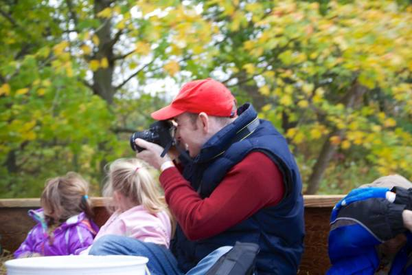 Louis shoots pictures of his kids, who were at the front of the wagon, which was overrun with baby bunnies