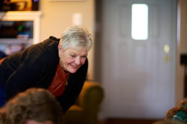 Proud Grandma Linda smiles at Baby Claire