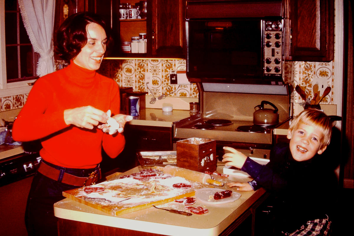 Christmas 1974, Jan, Doug making ginger man cookies?