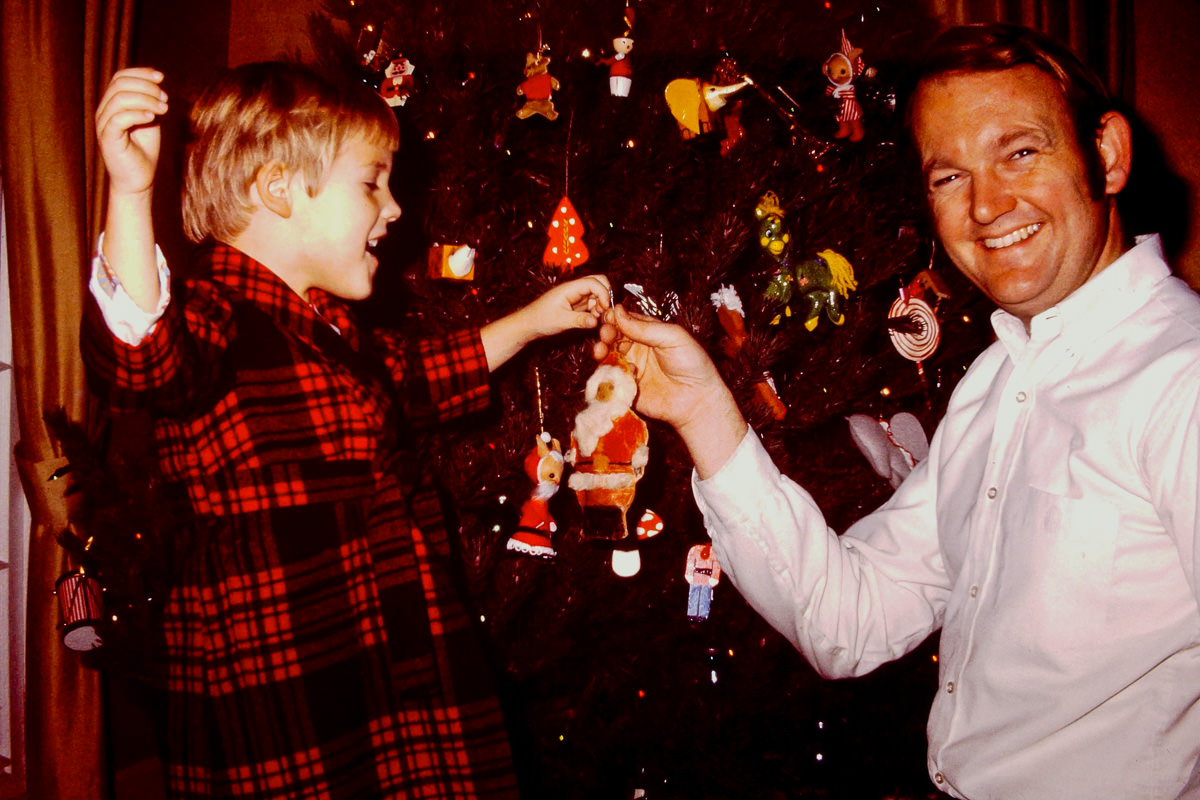 Christmas 1974: Doug helping Bill put the old old Santa (I think Bill made it as   a kid?) on the tree