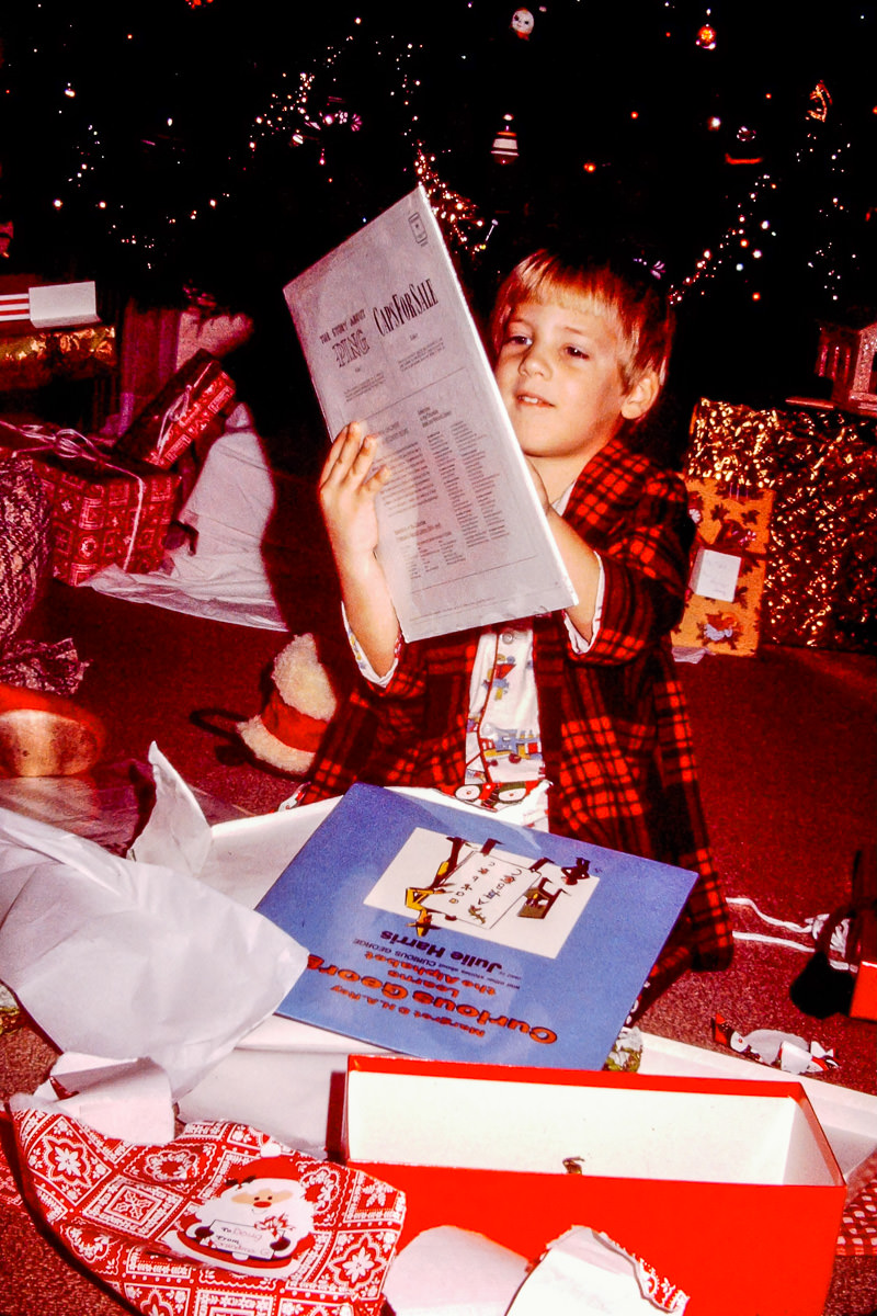 """Christmas 1974: Doug opens LP albums (!) of """"Caps for Sale"""" and """"Curious George Learns the  Alphabet"""""""