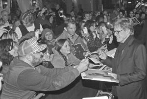 Mr. Redford signs autographs on the Arlington Theatre red carpet Friday on his way to receive the Santa Barbara International Film Festival's Cinema Vanguard award.