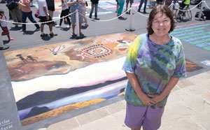 Artist Jessea Gay Marie created a 12-foot by 16-foot chalk work of a Chumash cave with art on the walls