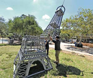 The Eiffel Tower is assembled at Oak Park for this weekend's French Festival.