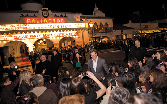 Colin Firth greets guests in front of the Arlington Theatre before walking down the red carpet at the Santa Barbara International Film Festival on Friday night. ROBBY BARTHELMESS / NEWS-PRESS