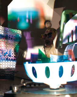 """Above and below: John Williams performs """"Record Projection"""" in 2009, with the help of record players, slides, Super-8 projectors and other mixed media. Courtesy photos"""
