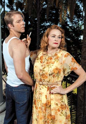"""Baritone Gregory Gerbrandt sings the role of Stanley Kowalski and soprano Beverly O'Regan Thiele makes her company debut as Blanche in Opera Santa Barbara's new production of André Previn's operatic version of """"A Streetcar Named Desire."""" David Bazemore"""