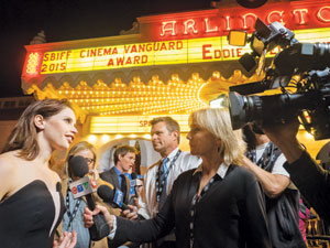 """Felicity Jones, star of """"The Theory of Everything,"""" speaks to reporters on the red carpet outside the Arlington Theatre on Thursday. Ms. Jones and co-star Eddie Redmayne received the Cinema Vanguard Award from the Santa Barbara International Film Festival NIK BLASKOVICH/ NEWS-PRESS"""