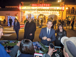 """Ethan Hawke signs autographs before the Santa Barbara International Film Festival's American Riviera Awards Tribute at the Arlington Theatre. Mr. Hawke and costar Patricia Arquette received the award for their work in """"Boyhood."""""""