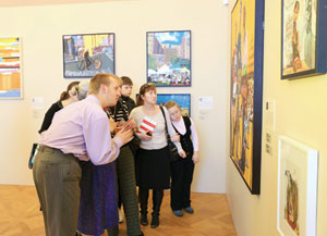 Kevin Hosseini's artwork on display at the Russian Museum in St. Petersburg, Russia, is shown on the wall behind the group.