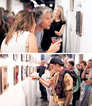Suzanne Dvanski, left, and Joe Cicero look over art on exhibit at the 2012 One Night Stand event Paull E. Rubin at the 2012 One Night Stand event Matt Wier photos