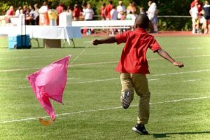"A student flies his group's""collapsible kite"""