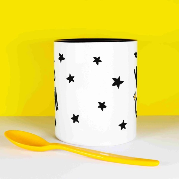 """Black and white mug that says """"Yaaas Queen"""", surrounded by black stars and a crown on the Q."""