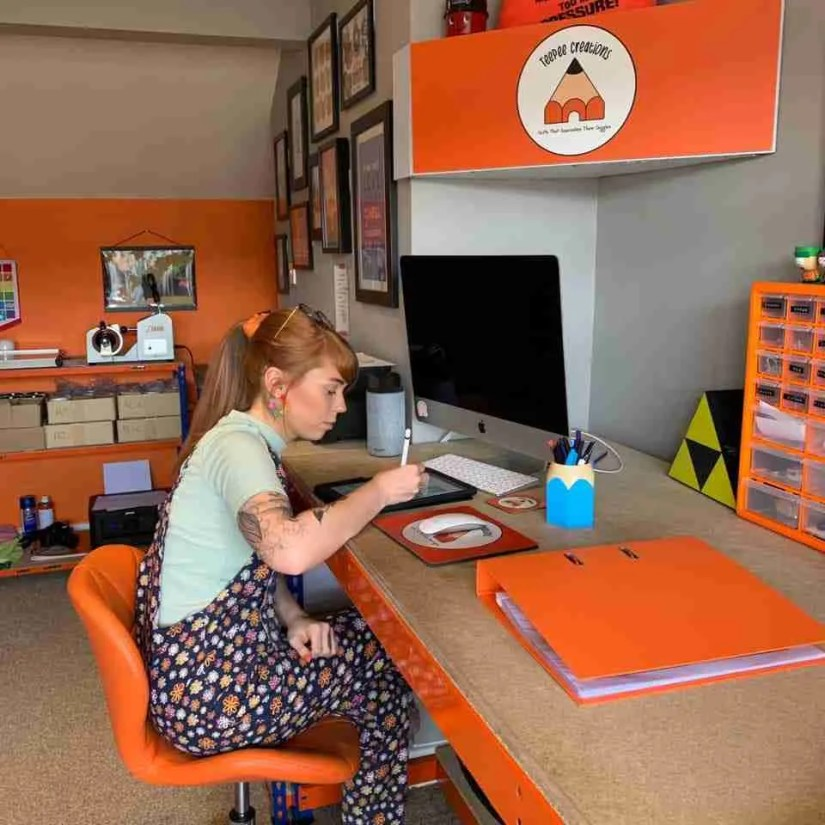 Toni Pilling sat at her TeePee Creations office desk drawing