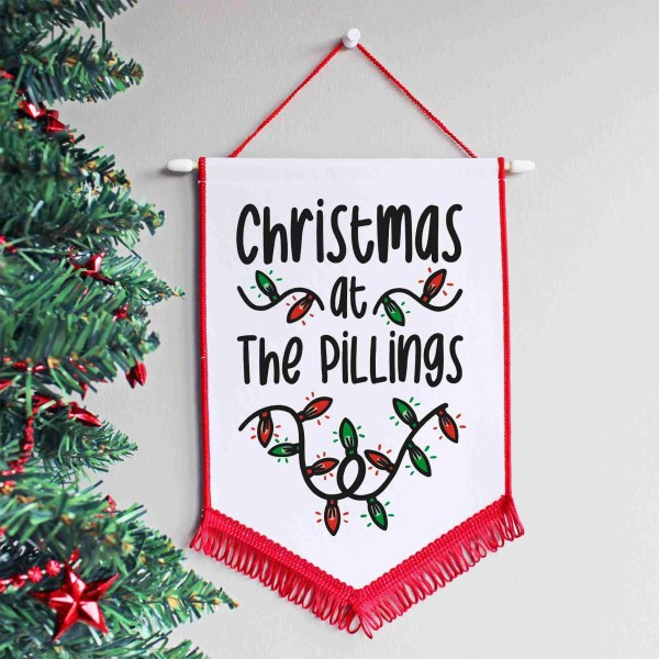 Red and white Christmas hanging pennant with customisable family design on the front.