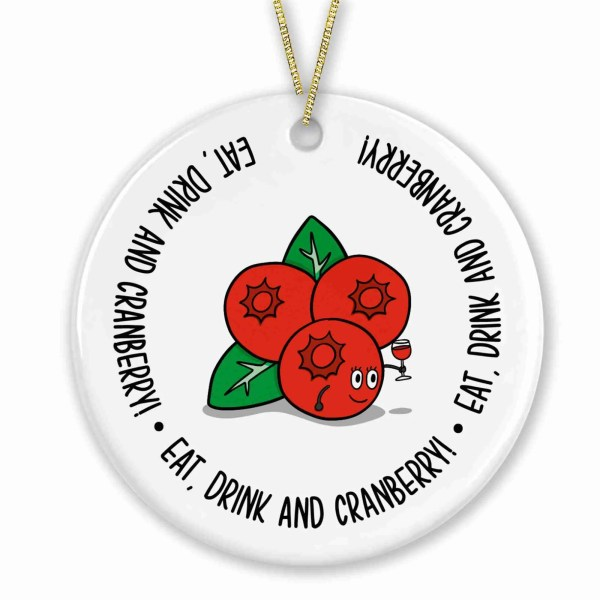 """Circle shaped bauble with cranberries illustration and the phrase """"Eat, Drink and Cranberry!"""" on the front."""