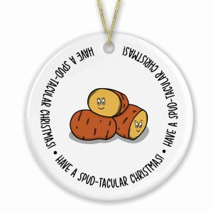 """Circle shaped bauble with potatoes illustration and the phrase """"Have a spud-tacular Christmas!"""" on the front."""