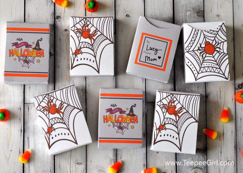 These free Halloween treat boxes are the perfect way to share treats and toys this holiday season! You can fill these boxes with candy, toys, crayons...anything! They are easy to put together and so cute! Grab them at www.TeepeeGirl.com.