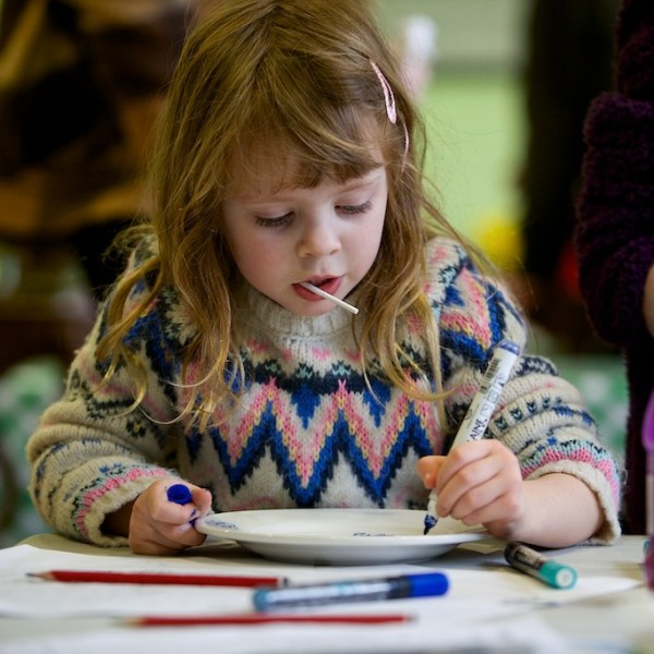 Girl making Willow Pattern Plates