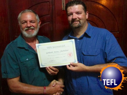 Gerhardt receiving his Certificate from TEFL International Cambodia, an international teacher training organisation.