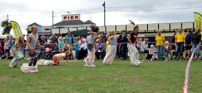 Teignmouth Regatta Sportsday on the Den. Sack Race. Some fallers on the final straight