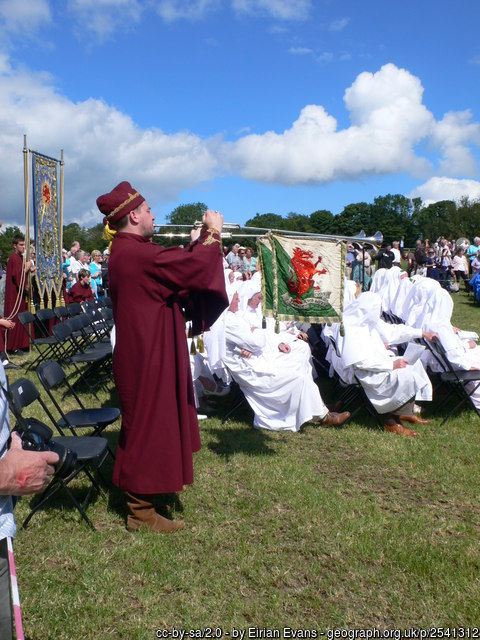 National Eisteddfod ceremony At the end of the ceremony for the initiation of honorary druids, the two heralds sound the horns before the singing of the National Anthem.