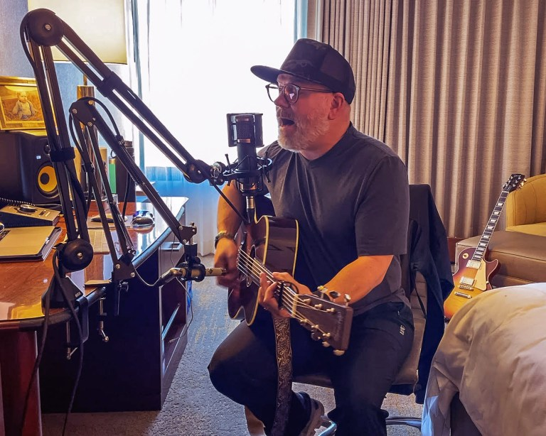"""Pete Mroz is seen in his hotel room preparing for a performance on """"The Voice."""" He has a Copperhead for his vocals and an ELA M260 on his guitar."""