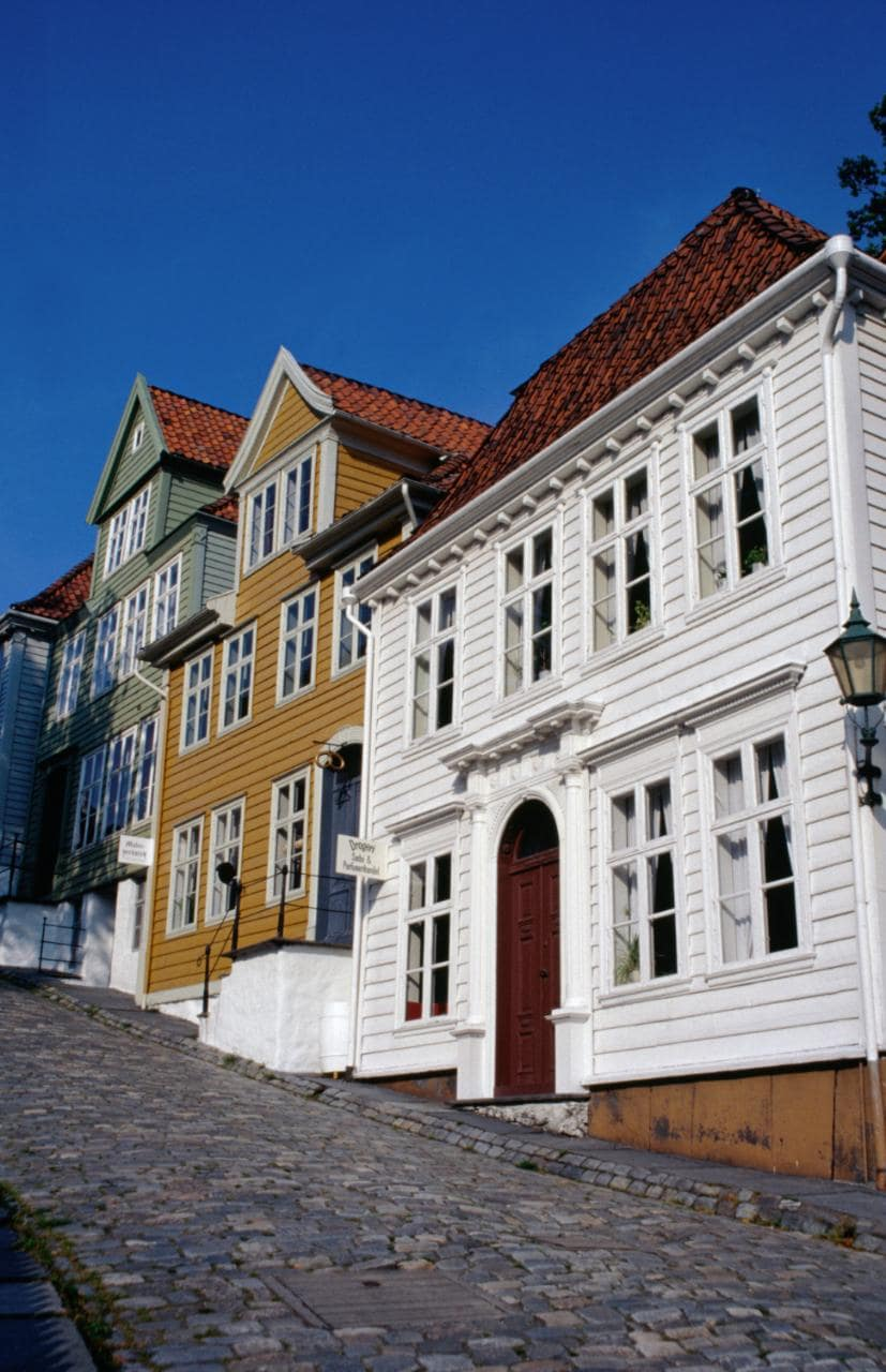 Historic wooden houses lining the quiet cobbled streets of Bergen