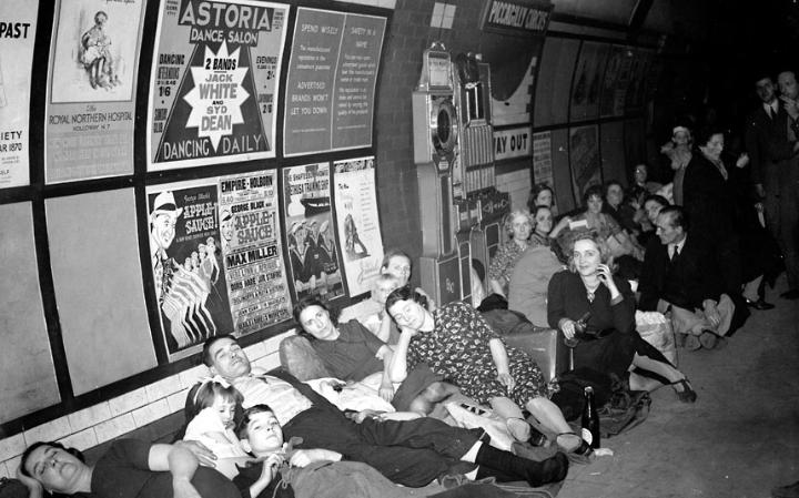 1940: People bed down for the night in an air raid shelter on a platform at Piccadilly Circus