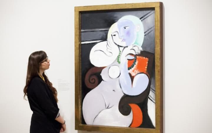 'Nude Woman in a Red Armchair' by Pablo Picasso, on display at Tate Britain in 2012