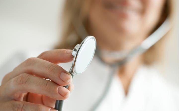 Doctor holding out stethoscope