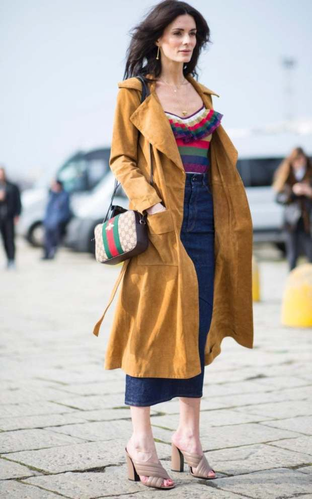 Hedvig Opshaug tones down her maximal ruffled Gucci striped top with a denim midi and dark tan trench