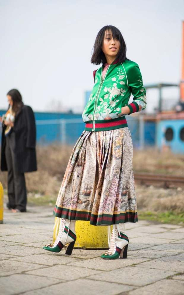 Margaret Zhang works spring's nascent satin bomber jacket trend, pairing her punchy green number with a full-skirted folk midi and Bowie-esque boots