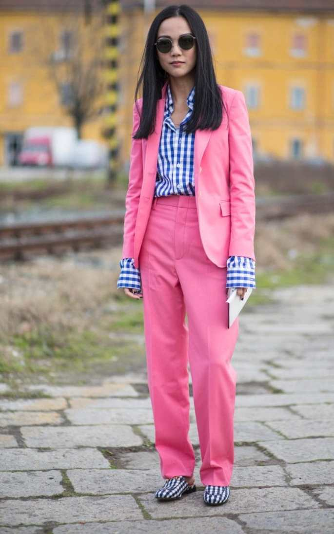 A zippy trouser suit in an eye-catching hue will always make an impact, yet this showgoer's exposed gingham cuffs really make this outfit sing
